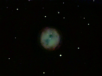 "M97  Owl Nebula. Taken at home on 04/04/05 and 04/09/05.  Meade LX200 GPS 8"" scope, DSI-C camera, alt/az mount, various filters. 10 seconds/image, total time 136 minutes."